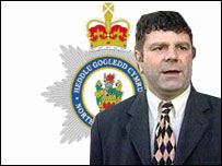 John Atkinson and North Wales Police crest graphic