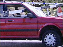 Car at scene of barrier coming down at Asda supermarket, Cardiff Bay, 2002.