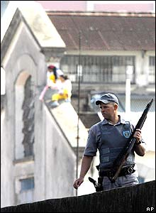 A policeman patrols a woman's prison in Sao Paulo