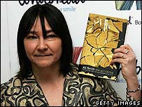 Author Ali Smith with a copy of her novel The Accidental