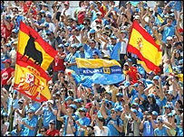 The home crowd at the Circuit de Catalunya celebrate Alonso's win