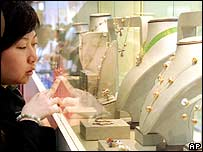Chinese shopper browses the jeweller's window