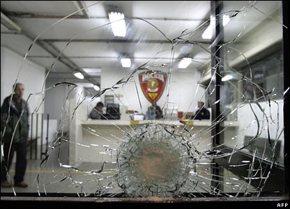 A bullet hole in the window of the Parada de Taipas police station