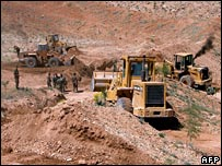 Bulldozers removing sand barriers in the Bekaa Valley