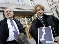 Paul and Barbara Kirwin stand with a photograph of their son Glenn Kirwin in Manhattan