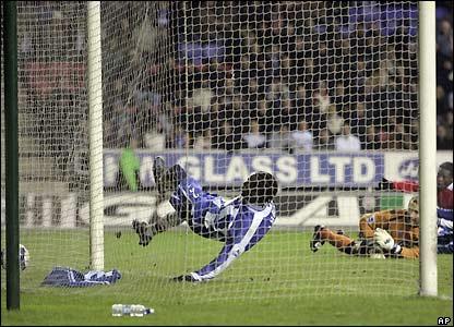 Pascal Chimbonda scores an own goal
