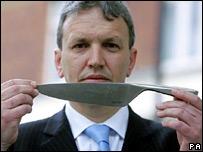 Det Supt Julian Worker with a John Lewis Evolution knife