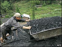 Chinese miner pushing a coal cart