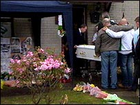 Coffin being brought into Michael McIlveen's family home