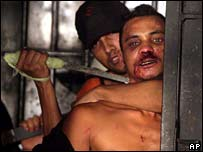 Prisoners hold a guard hostage with a knife at the Campo Mourao, in Parana