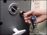 Prison warder locking cell door