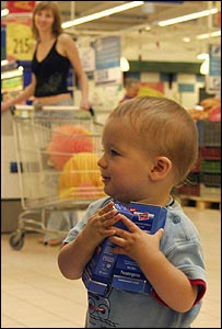 Mother and son shop at a Tesco store in Hungary