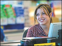 Checkout girl at a Tesco store in Ireland