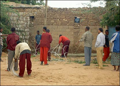 People fixing electric power supply in Dire Dawa, Ethiopia [Pic by BBC News website reader Biniam]