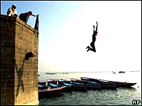 A boy jumps into the Ganges from one of the ghats