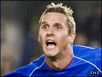 Peter Lovenkrands celebrates opening the scoring for Rangers
