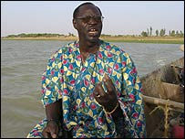 Ali Farka Toure in his river canoe on the Niger River