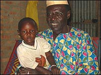 Ali Farka Toure and his youngest daughter at his home in Niafunke