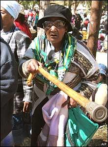 Woman participant at Pretoria march shakes stick  09 Aug