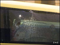 The smashed window on the Villarreal team bus