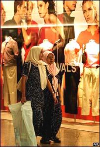 Malaysian women shop at a mall in Kuala Lumpur