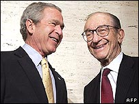 Alan Greenspan, on right, jokes with US President George W Bush