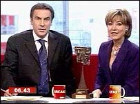 Dermot Murnaghan and Sian Williams with the TRIC award (centre)