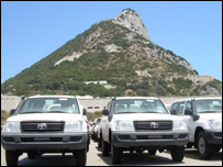 Vehicles parked beneath the Rock of Gibraltar