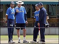 The Indian players examine the pitch with coach Greg Chappell