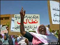 Sudanese women hold placards to demonstrate against the deployment of UN troops in the Darfur in Khartoum on Tuesday