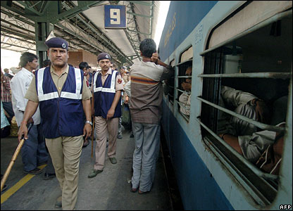 Indian Railway Protection Special Forces (RPSF) officials patrol a platform at Delhi Railway Station 08 March 2006