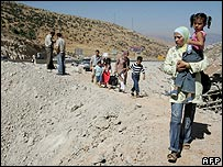 Lebanese make their way through rubble at the Masnaa border crossing into Syria on 7 August 2006