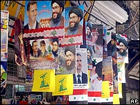 Posters of Syrian President Bashar Assad and Hezbollah leader Sheikh Hassan Nasrallah in old Damascus