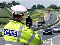 Police officer by motorway