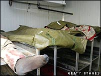 Bodies of Iraqi men lie in a hospital morgue on 8 March 2006