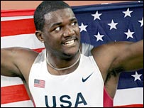 Justin Gatlin celebrates after winning gold in Athens