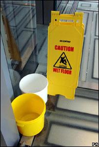 Buckets and a warning sign on the Senedd floor