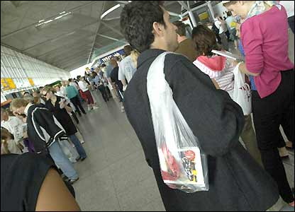 A man waiting in a security queue at Stansted