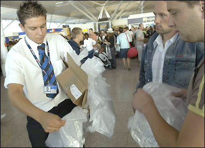 Scott Howell of Stansted airport handing out plastic bags
