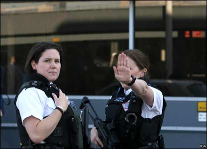 Police officers blocking access to Heathrow