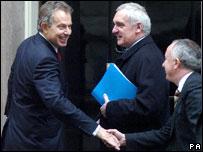 Tony Blair greets Taoiseach Bertie Ahern and Irish Foreign Minister Dermot Ahern