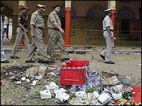 Policemen inspect the site of the blast at the Sankat Mochan temple, Varanasi