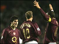 Cesc Fabregas, Dennis Bergkamp and Thierry Henry celebrate victory