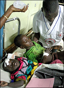Two young survivors are nursed at Mulago Hospital in Kampala
