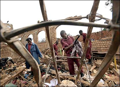 Local Defense Unit (LDU) Security soldiers search the remains of Kalerwe Church
