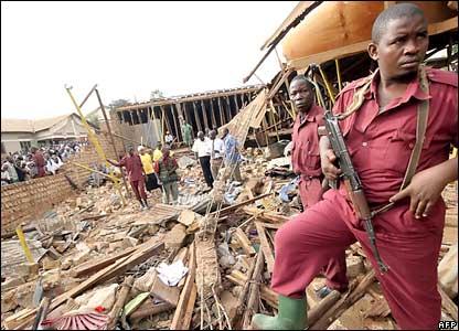 Local Defense Unit (LDU) Security guard the remains of Kalerwe Church