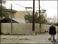 A man walks past the al-Rawafed Security Company compound
