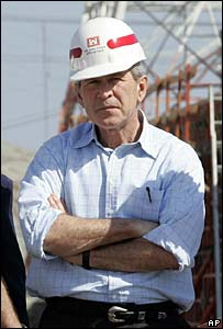 George W Bush watches reconstruction work being done in New Orleans