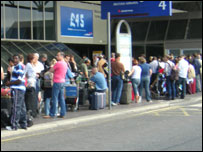 Passengers at Heathrow queue to get into the airport