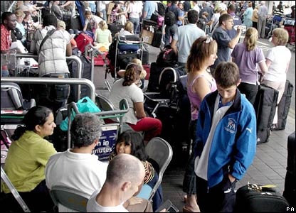 Passengers queue outside Heathrow's Terminal Four on Thursday afternoon